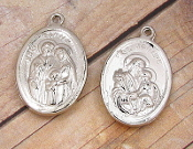"Silver Plated Finish Saint Joseph & Holy Family Medal 1"" oval-Silver-plated charms, a charm coated with an old-fashioned heirloom finish. Its Silver finish will provide the elegant and classic look of a family heirloom"